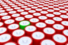 3D Illustration - Group of red batteries with one green batterie. Group of red batteries with one green batterie Royalty Free Stock Photo