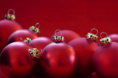 Group of red christmas balls, red background, copy space Royalty Free Stock Images