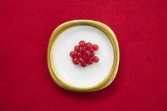 Group of red currants placed on a golden dish with  red Stock Photos