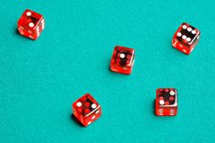Group of red dices on the green cloth. Five red dices on the green cloth Royalty Free Stock Photo