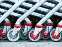 Group of red and gray shopping cart wheels Royalty Free Stock Photography