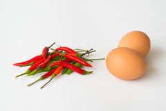 Group of red and green hot chili pepper with egg Royalty Free Stock Image