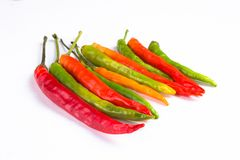 Group of red green and yellow peppers on white background royalty free stock images