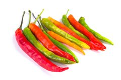 Group of red green and yellow peppers on white background stock photo
