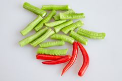 Group of red hot chilli and cow-pea long bean chopped on white background - top view, closed up stock photography