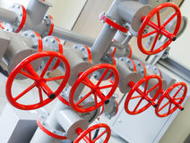 Group of red industrial valves Stock Photo