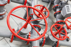 Group of red industrial valves Stock Photography