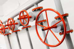 Group of red industrial valves on pipeline Stock Photography