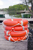 Group red life buoy on lake bridge Stock Images