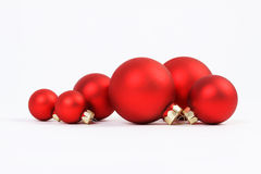 Group of red matt christmas balls on white background Stock Image