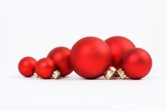 Group of red matt christmas balls on white background. Horizontal Stock Image
