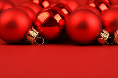 Group of red matt and glossy christmas balls on red background Royalty Free Stock Photos
