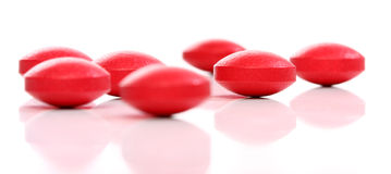 Group of red medicine pills Royalty Free Stock Photos