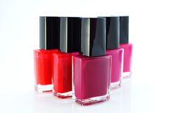 Group of red nail polishes on white. Bottles with red nail polish over white background Royalty Free Stock Image