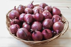 Group of red onions in a wicker basket. Horizontal composition Stock Photography