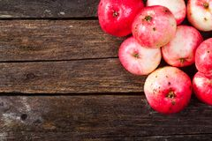 Red ripe apples. Group of red ripe apples on the vintage wooden table stock photography