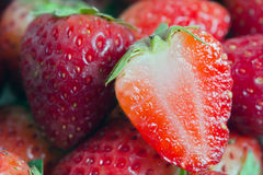 Group of of red ripe strawberry fruit with half cross section Royalty Free Stock Images