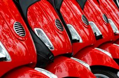 Group of red scooters royalty free stock images