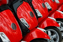 Group of red scooters stock images