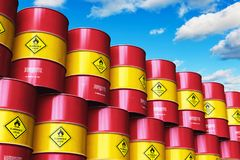 Group of red stacked oil drums against blue sky with clouds. Creative abstract oil and gas industry manufacturing and trading business concept: 3D render Stock Image