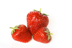 Group of the red strawberries isolated on white. Buckground Stock Photo