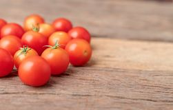 Group red tomatoes on the wooden table royalty free stock image