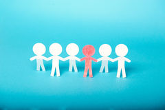 A group of red and white paper people Stock Image