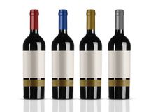 Group of red wine bottles with white label stock images