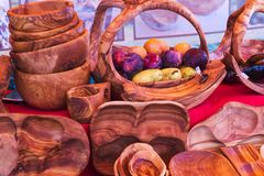 Group of red wooden bowls. In a stall for sale in the market Stock Images