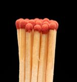 Group of red wooden matches on black background. Group of red wooden matches isolated on black background Royalty Free Stock Photography