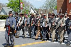 Group of Reenactors Parading in Bedford, Virginia - 2. Bedford County, Virginia, USA – April 29th: A group of reenactors marching down a street in Bedford at Stock Images
