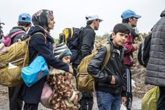 Group of refugees, mainly children, waiting to cross the Croatia Serbia border, between the cities of Bapska and Berkasovo. Picture of a groupe of refugees royalty free stock image