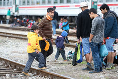 Group of refugees on train tracks Royalty Free Stock Photos
