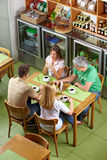 Group of regulars in restaurant Royalty Free Stock Photo