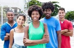 Group of relaxed mixed young adults in city Stock Photo
