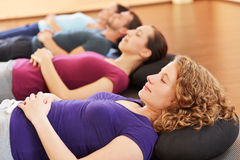 Group relaxing in fitness center royalty free stock images