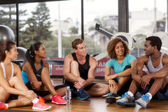 Group relaxing before a gym class. Multi-ethnic group relaxing before their gym glass Stock Photography