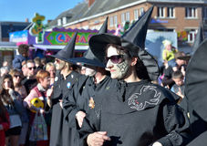 Group representing witches in black costumes in defile during yearly carnival Royalty Free Stock Photos