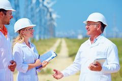 Group of researchers on wind power station Stock Photography