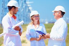 Group of researchers on wind power station Stock Photo