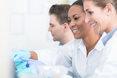 Group of researchers during work on devices in laboratory stock image