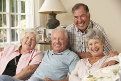 Group Of Retired Friends Sitting On Sofa At Home Together Stock Image