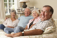 Group Of Retired Friends Sitting On Sofa At Home Together Royalty Free Stock Image