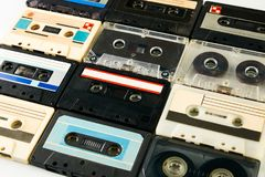 Group of retro audio cassettes. Isolated on white background, close-up, top view. Tape and audio, music and sound, media and record royalty free stock photography