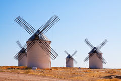 Group of retro windmills in field Stock Photography