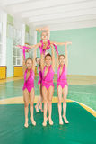 Group rhythmic gymnasts carrying out their routine Royalty Free Stock Images