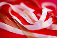 Group of ribbons on red background Stock Photo