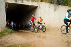 Group of riders exiting a tunnel Royalty Free Stock Photography
