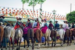 Group of riders on horseback at the April Fair, Seville Fair Feria de Sevilla royalty free stock photo