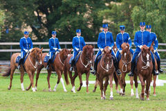 A group of riders from the mounted guard entering the arena Stock Photo